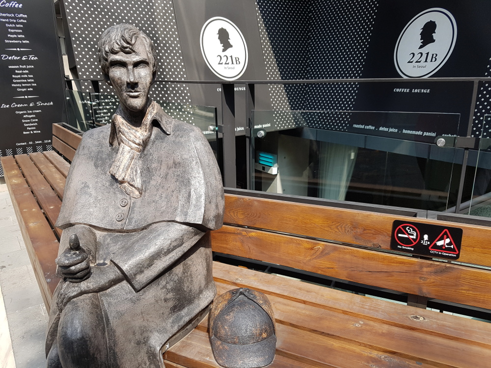 Benedict Cumberbatch as Sherlock statue. 221B Cafe in Seoul. Sherlock cafe. The Baker Street Babes. www.bakerstreetbabes.com